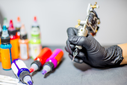 tattoo equipment machine and colorful ink in a workshop